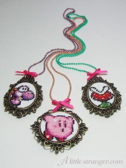 video game cross stitch necklaces